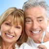 Smiling Couple with Toothbrushes